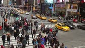 vezes : USA, New York City - December 26,2015: Crossroads W45th Street and 7th Avenue. Traffic cars, taxis and pedestrians. Editorial use only