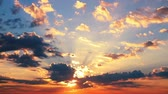 sky : Dawn. Colorful clouds run through the sky. The sunlight and shadows. Time lapse Stock Footage