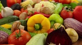 картофель : A lot of vegetables on a wooden table. Tomatoes, cucumbers, bell peppers, garlic, beets, zucchini, mushrooms, carrots, cauliflower, Chinese cabbage, potatoes, onions