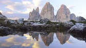 matterhorn : Morning in the Dolomites. Three mountain peaks and reflections in a small lake