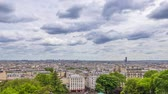 french street : France Paris Summer day. Panoramic view of the roofs. The clouds are running fast. The Eiffel Tower is not visible. Time lapse Stock Footage