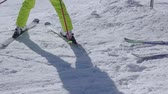 断る : Sunny snow slope. A beginner skier makes a turn. Skiing close up. Slow motion