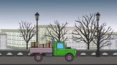 Animated green truck with boxes in the trunk riding through autumn city. Moving heavy car on cityscape background. Flat animation Стоковые видеозаписи
