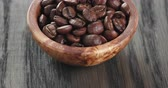кофе в зернах : freshly roasted arabica coffee beans in bowl