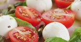 capers : caprese salad with mozzarella balls and tomatoes
