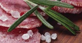 dry sausage : italian salami sausage slices with rosemary and sea salt Stock Footage