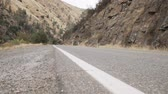 eastern sierra : gimbal forward shot of road near merced river Stock Footage