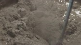 harç : Slow motion pan shot of mixing concrete plaster with electric mixer Stok Video
