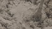 perfurar : Slow motion handheld shot of mixing concrete plaster with electric mixer