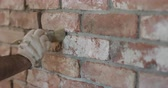 разрыв : Slow motion closeup of worker forming seam between bricks