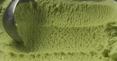 fattening : Slow motion closeup matcha ice cream scooping Stock Footage