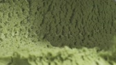orzechy włoskie : Slow motion of pistachio ice cream being scooped close up