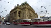 nézett : Prague Prague National Theatre nrodn Divadlo is known as the Alma Mater of Czech opera and as the national monument of Czech history and art daytime traffic and tram moving in front of building 4k