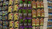 holandês : Dutch refrigerator magnets in a tourist shop in Holland the Netherlands very colorful display with small Dom Towers tulips canalhouses wooden shoes made magnets for tourism popular as presents 4k