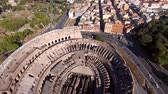flavian : Aerial flying Colosseum birdview also known as Coliseum or Flavian Amphitheatre or Colosseo oval amphitheater center Rome Italy largest amphitheater ever built popular tourist attraction 4k