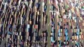 čtyřicet : Aerial top down view flying straight over container terminal showing many intermodal containers used for freight transport shipping goods stacked up on eachother different colors harborareaparanormal 4k