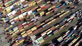 čtyřicet : Aerial top down view flying over container terminal showing many intermodal containers used for freight transport shipping goods stacked up on eachother different colors cranes moving in between 4k
