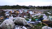 terra : traffic near dump trash by the road