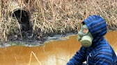industrial : man with protective mask Liquid toxic color waste