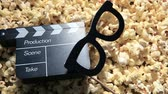 koltuk : pop corn paper mask clapper board hd footage