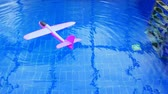 pink toy airplane swimming pool nobody hd footage