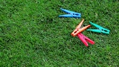 bright clothes : clothespin green grass background nobody hd footage Stock Footage