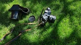 maleta antigua : old camera green grass tree shadow background nobody hd footage Archivo de Video