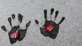 wool gloves hand trace snow background hd footage Stockvideo
