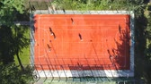 ipuçları : Aerial top-down view friends playing basketball at outdoor open court in city park. Drone overhead footage