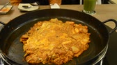 stirfry : How to cook Korean cuisine called Dak galbi step 5, put slice cheese then stir-fry all ingredients together