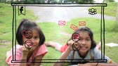 Asian Thai girl children couple is pressing motion graphic doodle social media sign and internet interface button and drawing symbol in the air with creative imagination in computer technology or education for poor rural kids concept. Stock Footage