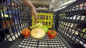 corredor : Close up of pushing shopping cart in supermarket Vídeos