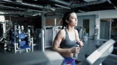 gym : Thirsty woman running on treadmills Stock Footage