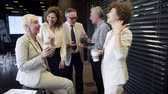piada : Business people in lobby during coffee break Stock Footage