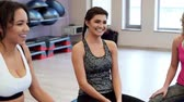 aerobic : Smiley young ladies having a chat on the gym