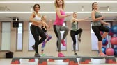 gymnastik : Full length of young women over exercising Stock Footage