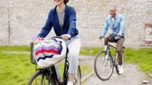 piada : Happy mixed race couple cycling