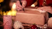 подарок : Human hand writing merry christmas on present