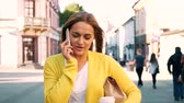 Woman using a telephone while walking Stock Footage