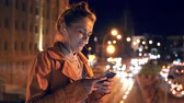 Woman spending night time in city Stock Footage