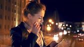 Student have a telephone call in the night city