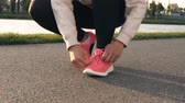 Human hand tying sports shoes Stock Footage