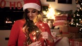 lareira : Woman has trouble with christmas lights Stock Footage