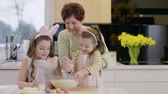 assistance : Grandmother and child making dough Stock Footage