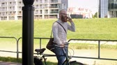 careca : Businessman with bicycle talking by mobile phone Stock Footage