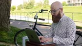 bank : Hipster businessman using a laptop outdoors