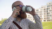 careca : Cheerful man talking by mobile phone in the city