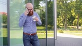 careca : Hipster businessman using mobile phone outdoors