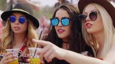 maravilhado : Friends drinking juice during the music festival Stock Footage