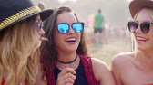 right : Young women talking during the music festival Stock Footage